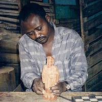 Edwin Carving a Small Statue